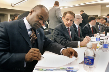DETROIT -  JANUARY 4:  DeMaurice Smith (L) Executive Director of the NFL Players Association, prepares to speak as a witness at a U.S. House Judiciary field hearing January 4, 2010 in Detroit, Michigan. The hearing was designed to consider recent steps ta