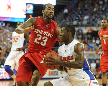 GAINESVILLE, FL - NOVEMBER 16: Guard Erving Walker #11 of the Florida Gators drives into guard David Lighty #23 of the Ohio State Buckeyes November 16, 2010 at the Stephen C. O'Connell Center in Gainesville, Florida.  (Photo by Al Messerschmidt/Getty Imag