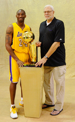 EL SEGUNDO, CA - SEPTEMBER 25:  Kobe Bryant #24 and head coach Phil Jackson of the Los Angeles Lakers pose with NBA Finals Larry O'Brien Championship Trophy as teammate Anthony Rob erson #0 looks on during Media Day at the Toyota Center on September 25, 2