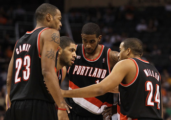 PHOENIX, AZ - JANUARY 14: (L-R) Marcus Camby #23, Nicolas Batum #88, LaMarcus Aldridge #12 and Andre Miller #24 of the Portland Trail Blazers huddle up during the NBA game against the Phoenix Suns at US Airways Center on January 14, 2011 in Phoenix, Arizo