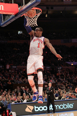 NEW YORK, NY - FEBRUARY 06:  Amar'e Stoudemire #1 of the New York Knicks dunks the ball against the Philadelphia 76ers at Madison Square Garden on February 6, 2011 in New York City. NOTE TO USER: User expressly acknowledges and agrees that, by downloading