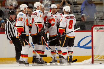 DENVER, CO - FEBRUARY 14:  (L-R) Robyn Regehr #28, Jay Bouwmeester #4, Rene Bourque #17, Jerome Iginla #12 and Brendan Morrison #8 of the Calgary Flames celebrate Iginla's first period goal to give the Flames a 3-0 lead over the Colorado Avalanche at the
