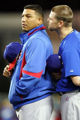 LOS ANGELES, CA - OCTOBER 04:  (L-R) Carlos Zambrano #38 and Kerry Wood #34 of the Chicago Cubs talk during pregame introductions before taking on the Los Angeles Dodgers in Game Three of the NLDS during the 2008 MLB playoffs on October 4, 2008 at Dodger