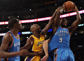 LOS ANGELES, CA - JANUARY 17:  Lamar Odom #7 of the Los Angeles Lakers is called for a foul on Serge Ibaka #9 of the Oklahoma City Thunder as Kevin Durant looks on during a 101-94 Laker win at the Staples Center on January 17, 2011 in Los Angeles, Califor