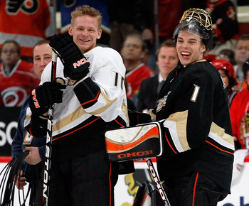 RALEIGH, NC - JANUARY 29:  Corey Perry #10 and Jonas Hiller #1 of the Anaheim Ducks smile during the Honda NHL SuperSkills competition part of 2011 NHL All-Star Weekend at the RBC Center on January 29, 2011 in Raleigh, North Carolina.  (Photo by Kevin C.