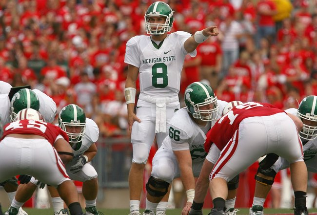 MADISON, WI - SEPTEMBER 26: Kirk Cousins #8 of the Michigan State Spartans motions on the line against the Wisconsin Badgers on September 26, 2009 at Camp Randall Stadium in Madison, Wisconsin. (Photo by Jonathan Daniel/Getty Images)