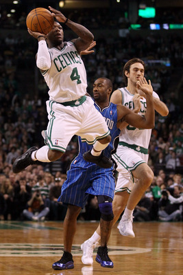 BOSTON, MA - FEBRUARY 06:  Nate Robinson #4 of the Boston Celtics takes a shot as Gilbert Arenas #1 of the Orlando Magic defends on February 6, 2011 at the TD Garden in Boston, Massachusetts. The Celtics defeated the Magic 91-80. NOTE TO USER: User expres