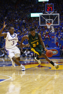 LAWRENCE, KS - FEBRUARY 9:  LaceDarius Dunn #24 of the Baylor Bears drives the ball against Russell Robinson #3 of the Kansas Jayhawks on February 9, 2008 at Allen Fieldhouse in Lawrence, Kansas.  Kansas defeated Baylor 100-90. (Photo by G. Newman Lowranc