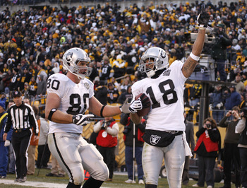 PITTSBURGH - DECEMBER 06:  Louis Murphy #18 of the Oakland Raiders celebrates the game winning touchdown with Zach Miller #80 while playing the Pittsburgh Steelers on December 6, 2009 at Heinz Field in Pittsburgh, Pennsylvania. Oakland won the game 27-24.