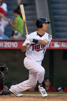 ANAHEIM, CA - JULY 13:  American League All-Star Joe Mauer #7 of the Minnesota Twins at bat during the 81st MLB All-Star Game at Angel Stadium of Anaheim on July 13, 2010 in Anaheim, California.  (Photo by Stephen Dunn/Getty Images)