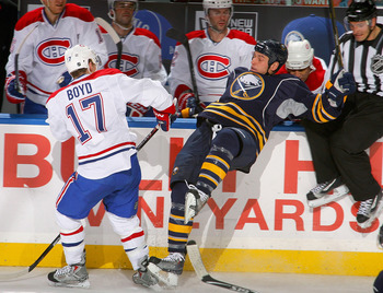 BUFFALO, NY - NOVEMBER 05: Dustin Boyd #17 of the Montreal Canadiens checks Cody McCormick #8 of the Buffalo Sabres on November 5, 2010 at the HSBC Arena in Buffalo, New York.  (Photo by Rick Stewart/Getty Images)