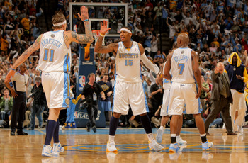 DENVER - MAY 03:  Chris Andersen #11, Carmelo Anthony #15 and Chauncey Billups #7 of the Denver Nuggets celebrate during a time out against the Dallas Mavericks in Game One of the Western Conference Semifinals during the 2009 NBA Playoffs at Pepsi Center