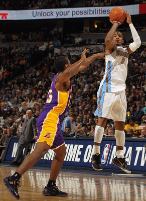 DENVER, CO - JANUARY 21:  J.R. Smith #5 of the Denver Nuggets takes a shot against Ron Artest #15 of the Los Angeles Lakers at the Pepsi Center on January 21, 2011 in Denver, Colorado. The Lakers defeated the Nuggets 107-97. NOTE TO USER: User expressly a