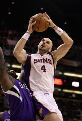 PHOENIX, AZ - FEBRUARY 13:  Marcin Gortat #4 of the Phoenix Suns attempts a shot against the Sacramento Kings during the NBA game at US Airways Center on February 13, 2011 in Phoenix, Arizona. The Kings defeated the Suns 113-108.  NOTE TO USER: User expre