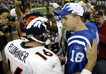 INDIANAPOLIS - JANUARY 4:  Quarterback Peyton Manning #18 of the Indianapolis Colts speaks to quarterback Jake Plummer #16 of the Denver Broncos during the AFC playoff game on January 4, 2004 at the RCA Dome in Indianapolis, Indiana. The Colts beat the Br