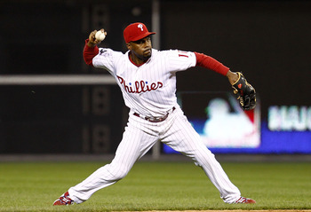 PHILADELPHIA - OCTOBER 08:  Jimmy Rollins #11 of the Philadelphia Phillies throws to first base in Game 2 of the NLDS against the Cincinnati Reds at Citizens Bank Park on October 8, 2010 in Philadelphia, Pennsylvania.  (Photo by Jeff Zelevansky/Getty Imag