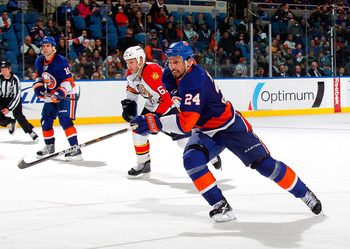 UNIONDALE, NY - NOVEMBER 20:  Radek Martinek #24 of the New York Islanders skates up ice during a hockey game against the Florida Panthers at the Nassau Coliseum on November 20, 2010 in Uniondale, New York.  (Photo by Paul Bereswill/Getty Images)