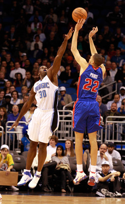 ORLANDO, FL - JANUARY 24:  Tayshaun Prince #22 of the Detroit Pistons attempts a shot over Brandon Bass #30 of the Orlando Magic during the game at Amway Arena on January 24, 2011 in Orlando, Florida.  NOTE TO USER: User expressly acknowledges and agrees