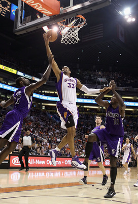 PHOENIX, AZ - FEBRUARY 13:  Grant Hill #13 of the Phoenix Suns lays up a shot past Tyreke Evans #13 and Samuel Dalembert #10 of the Sacramento Kings during the NBA game at US Airways Center on February 13, 2011 in Phoenix, Arizona.  NOTE TO USER: User exp