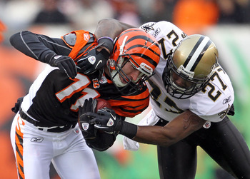 CINCINNATI, OH - DECEMBER 05:  Malcolm Jenkins #27 of the New Orleans Saints tackles Jordan Shipley #11 of the Cincinnati Bengals during the NFL game at Paul Brown Stadium on December 5, 2010 in Cincinnati, Ohio.  The Saints won 34-30.  (Photo by Andy Lyo