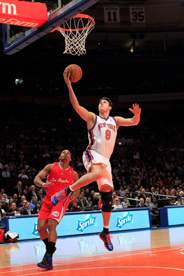 NEW YORK, NY - FEBRUARY 09:  Danilo Gallinari #8 of the New York Knicks lays the ball up over Randy Foye #4 of the Los Angeles Clippers at Madison Square Garden on February 9, 2011 in New York City. NOTE TO USER: User expressly acknowledges and agrees tha