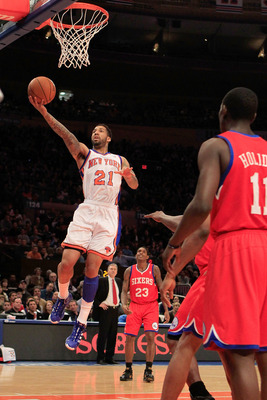 NEW YORK, NY - FEBRUARY 06: Wilson Chandler #21 of the New York Knicks lays the ball up against the Philadelphia 76ers at Madison Square Garden on February 6, 2011 in New York City. NOTE TO USER: User expressly acknowledges and agrees that, by downloading