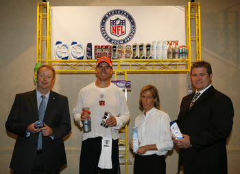 GEORGETOWN, KY -(LtoR) NFL Senior VP of Sales Mark Waller, Cincinnati Bengals' quarterback Carson Palmer, Cincinnati Bengals' Executive Vice President Katie Blackburn and P&G Director of Global Sports Marketing pose for a picture during the P&G NFL Partne