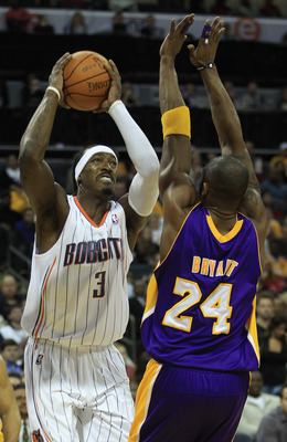 CHARLOTTE, NC - FEBRUARY 14:  Kobe Bryant #24 of the Los Angeles Lakers tries to stop Gerald Wallace #3 of the Charlotte Bobcats during their game at Time Warner Cable Arena on February 14, 2011 in Charlotte, North Carolina. NOTE TO USER: User expressly a