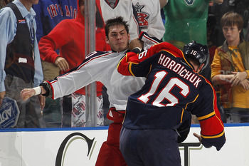 SUNRISE, FL - JANUARY 19: Darcy Hordichuk #16 of the Florida Panthers and Jared Boll #40 of the Columbus Blue Jackets fight during the second period on January 19, 2011 at the BankAtlantic Center in Sunrise, Florida. (Photo by Joel Auerbach/Getty Images)