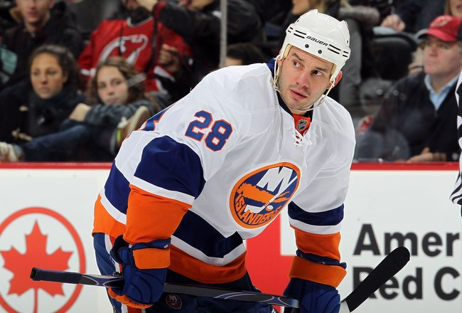 NEWARK, NJ - DECEMBER 23:  Zenon Konopka #28 of the New York Islanders skates against the New Jersey Devils at the Prudential Center on December 23, 2010 in Newark, New Jersey. The Isles defeated the Devils 5-1.  (Photo by Jim McIsaac/Getty Images)