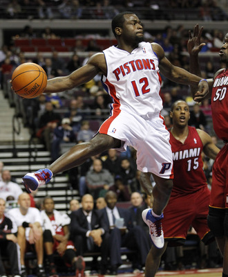 AUBURN HILLS, MI - FEBRUARY 11:  Will Bynum #12 of the Detroit Pistons look for a pass next to Mario Chalmers #15 at The Palace of Auburn Hills on February 11, 2011 in Auburn Hills, Michigan. Miami won the game 106-92. NOTE TO USER: User expressly acknowl