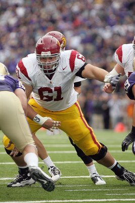 SEATTLE - SEPTEMBER 19:  Center Kristofer O'Dowd #61 of the USC Trojans moves on the line during the game against the Washington Huskies on September 19, 2009 at Husky Stadium in Seattle, Washington. The Huskies defeated the Trojans 16-13. (Photo by Otto