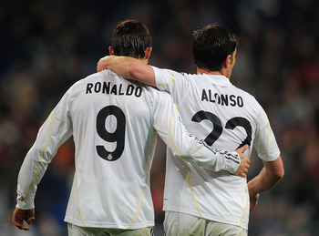 MADRID, SPAIN - FEBRUARY 21: Xabi Alonso of Real Madrid is congratulated by Cristiano Ronaldo after he scored from the penalty spot during the La Liga match between Real Madrid and Villarreal at Estadio Santiago Bernabeu on February 21, 2010 in Madrid, Sp