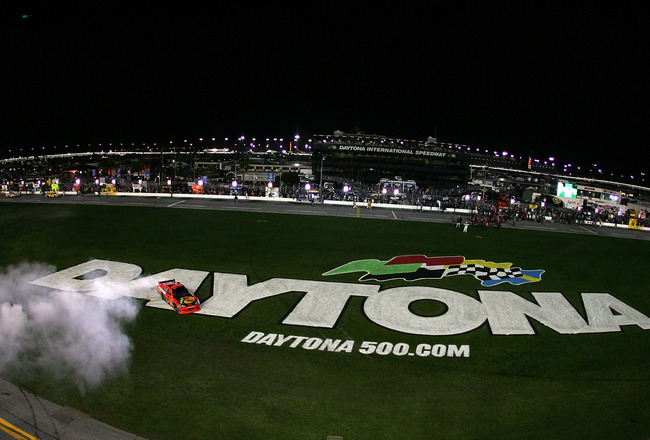 DAYTONA BEACH, FL - FEBRUARY 14:  Jamie McMurray, driver of the #1 Bass Pro Shops/Tracker Boats Chevrolet, celebrates with a burnout after winning the NASCAR Sprint Cup Series Daytona 500 at Daytona International Speedway on February 14, 2010 in Daytona B
