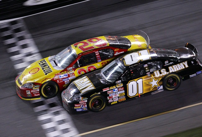 DAYTONA, FL - FEBRUARY 18:  Kevin Harvick, driver of the #29 Shell/Pennzoil Chevrolet, leads Mark Martin, driver of the #01 U.S. ARMY Chevrolet, to the finish line to win the NASCAR Nextel Cup Series Daytona 500 at Daytona International Speedway on Februa