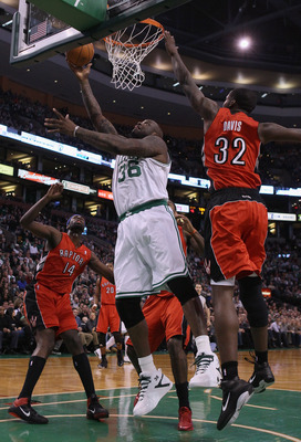 BOSTON, MA - JANUARY 07:  Shaquille O'Neal #36 of the Boston Celtics heads for the basket as Julian Wright #14 and Ed Davis #32 of the Toronto Raptors defend on January 7, 2011 at the TD Garden in Boston, Massachusetts. NOTE TO USER: User expressly acknow