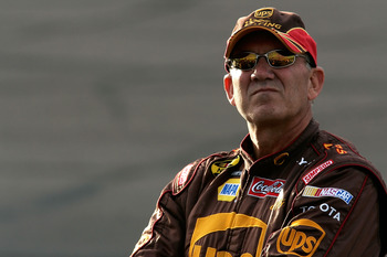 AVONDALE, AZ - NOVEMBER 09: Dale Jarrett, driver of the #44 UPS Toyota, stands on the grid during qualifying for the NASCAR Nextel Cup Series Checker Auto Parts 500 at Phoenix International Raceway on November 9, 2007 in Avondale, Arizona.  (Photo by Jaso
