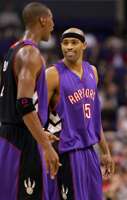 LOS ANGELES - NOVEMBER 16:  Chris Bosh #4 and Vince Carter #15 of the Toronto Raptors talk during the game the Los Angeles Clippers at Staples Center on November 16, 2004 in Los Angeles, California.  NOTE TO USER: User expressly acknowledges and agrees th