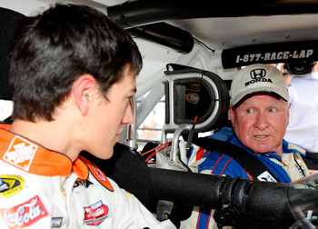 DARLINGTON, SC - APRIL 22:  NASCAR Sprint Cup driver Joey Logano takes advice from NASCAR legend Cale Yarborough during a promotional event for the Southern 500 on April 22, 2009 at Darlington Raceway in Darlington, South Carolina.  (Photo by Rusty Jarret