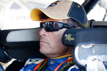DAYTONA BEACH, FL - FEBRUARY 12:  Michael Waltrip, driver of the #15 NAPA Toyota, sits in his car during practice for the NASCAR Sprint Cup Series Daytona 500 at Daytona International Speedway on February 12, 2011 in Daytona Beach, Florida.  (Photo by Chr