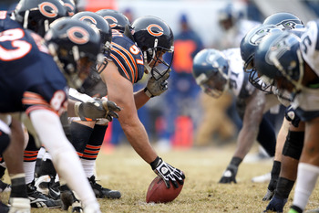 CHICAGO, IL - JANUARY 16:  Center Olin Kreutz #57 of the Chicago Bears prepares to snap the ball against the Seattle Seahawks in the first half in the 2011 NFC divisional playoff game at Soldier Field on January 16, 2011 in Chicago, Illinois.  (Photo by A
