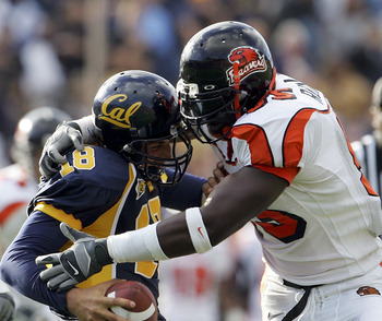 BERKELEY, CA - OCTOBER 15:  Quarterback Joe Ayoob #18 of the California Golden Bears is tackled by Joe Rudulph #95 of the Oregon State Beavers during the fourth quarter of the game at Memorial Stadium on October 15, 2005 in Berkeley, California. Oregon St