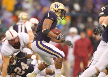 SEATTLE - OCTOBER 30:  Running back Chris Polk #1 of the Washington Huskies rushes against the Stanford Cardinal on October 30, 2010 at Husky Stadium in Seattle, Washington. Stanford won 41-0. (Photo by Otto Greule Jr/Getty Images)