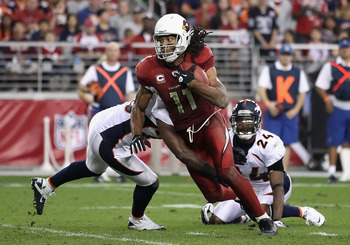 GLENDALE, AZ - DECEMBER 12:  Wide receiver Larry Fitzgerald #11 of the Arizona Cardinals runs with the football after a reception during the NFL game against the Denver Broncos at the University of Phoenix Stadium on December 12, 2010 in Glendale, Arizona