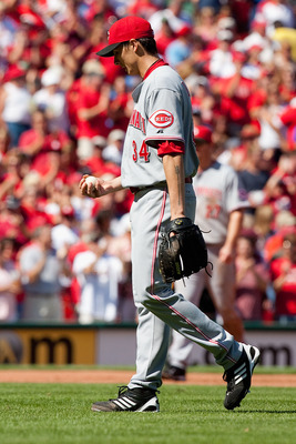ST. LOUIS - SEPTEMBER 5: Homer Bailey #34 of the Cincinnati Reds reacts to giving up a three-run home run against the St. Louis Cardinals at Busch Stadium on September 5, 2010 in St. Louis, Missouri.  The Cardinals beat the Reds 4-2.  (Photo by Dilip Vish