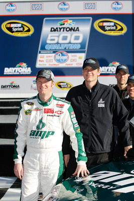 DAYTONA BEACH, FL - FEBRUARY 13:  Pole award winner Dale Earnhardt Jr., driver of the #88 National Guard/AMP Energy Chevrolet, poses in victory lane after qualifying for the NASCAR Sprint Cup Series Daytona 500 at Daytona International Speedway on Februar