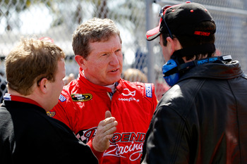DAYTONA BEACH, FL - FEBRUARY 12:  Bill Elliott, driver of the #09 Phoenix Construction Chevrolet, speaks with crew members during practice for the NASCAR Sprint Cup Series Daytona 500 at Daytona International Speedway on February 12, 2011 in Daytona Beach
