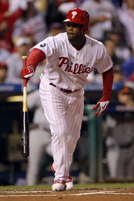 PHILADELPHIA - OCTOBER 17:  Jimmy Rollins #11 of the Philadelphia Phillies walks with the bases loaded to score Chase Utley #26 in the first inning against the San Francisco Giants in Game Two of the NLCS during the 2010 MLB Playoffs at Citizens Bank Park