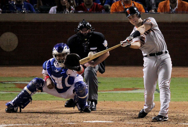 ARLINGTON, TX - OCTOBER 31:  Buster Posey #28 of the San Francisco Giants hits a home run against the Texas Rangers during the top of the eighth inning in Game Four of the 2010 MLB World Series at Rangers Ballpark in Arlington on October 31, 2010 in Arlin