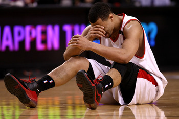 PORTLAND, OR - APRIL 18:  Brandon Roy #7 of the Portland Trail Blazers holds his face after being injured during a scramble for the ball against  the Houston Rockets during Game One of the Western Conference Quarterfinals of the 2009 NBA Playoffs on April